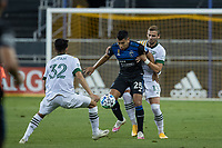 SAN JOSE, CA - SEPTEMBER 16: Dario Zuparic #13 & Marco Farfan #32 of the Portland Timbers & Andres Rios #25 of the San Jose Earthquakes battle for the ball during a game between Portland Timbers and San Jose Earthquakes at Earthquakes Stadium on September 16, 2020 in San Jose, California.
