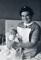 "COPY BY TOM BEDFORD<br /> Pictured: Undated picture of midwife Joan Phillips with one of the babies she helped deliver.<br /> Re: A midwife had her dying wish granted when an undertaker she delivered more than 50 years ago arranged her funeral in Haverfordwest, Pembrokeshire.<br /> Joan Phillips told undertaker Robin Folland: ""I brought you into the world so I want you to take me out of it.""<br /> The pair joked about the unusual arrangement for years when they saw each other in the street.<br /> But when Joan passed away aged 88 Robin stepped in to give her a good send off.<br /> Robin, 54, said: ""Joan lived nearby and when my mum went into labour she was there to deliver me.<br /> ""When I started working for my dad's funeral company Joan told me I had to look after her when the time came.<br /> ""She used to say that she brought me into the world so I had to take her out of it."