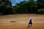 A Catholic nun walks along a road outside of a cathedral in southern Tanzania on November 8, 2008.