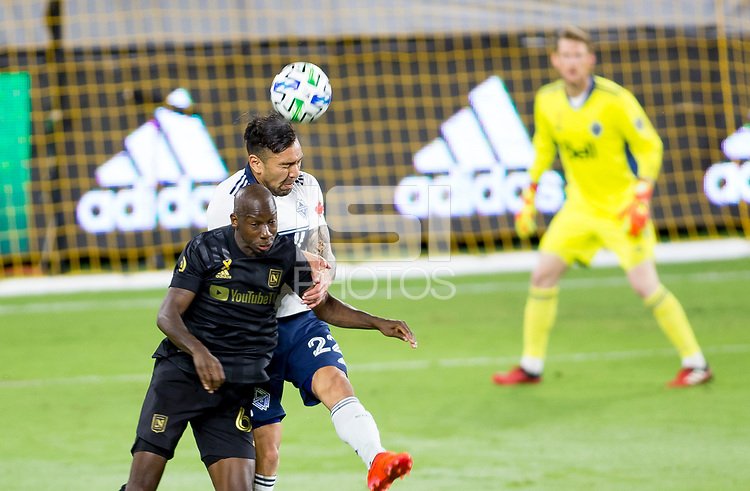 LOS ANGELES, CA - SEPTEMBER 23: Bradley Wright-Phillips #66 of LAFC and Erik Godoy #22 of the Vancouver Whitecaps fight in the air for a ball during a game between Vancouver Whitecaps and Los Angeles FC at Banc of California Stadium on September 23, 2020 in Los Angeles, California.