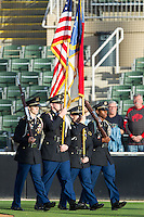 """The East Rowan High School Junior ROTC presents the colors on """"Military Appreciation Night"""" prior to the South Atlantic League game between the West Virginia Power and the Kannapolis Intimidators at CMC-Northeast Stadium on May 1, 2014 in Kannapolis, North Carolina.  The Power defeated the Intimidators 5-4.  (Brian Westerholt/Four Seam Images)"""