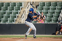 Omar Carrizales (19) of the Asheville Tourists at bat against the Kannapolis Intimidators at Intimidators Stadium on June 28, 2015 in Kannapolis, North Carolina.  The Tourists defeated the Intimidators 6-4.  (Brian Westerholt/Four Seam Images)