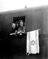 These Jewish children are on their way to Palestine after having been released from the Buchenwald Concentration Camp.  The girl on the left is from Poland, the boy in the center from Lativa, and the girl on right from Hungary.  June 5, 1945. T4c. J. E. Myers. (Army)<br /> Exact Date Shot Unknown<br /> NARA FILE #:  111-SC-207907<br /> WAR & CONFLICT BOOK #:  1262