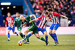 Daniel Ceballos Fernandez 'Dani Ceballos' (l) of Real Betis Balompie competes for the ball with Gabriel Fernandez Arenas 'Gabi' (c) and Saul Niguez Esclapez of Atletico de Madrid during their La Liga 2016-17 match between Atletico de Madrid vs Real Betis Balompie at the Vicente Calderon Stadium on 14 January 2017 in Madrid, Spain. Photo by Diego Gonzalez Souto / Power Sport Images