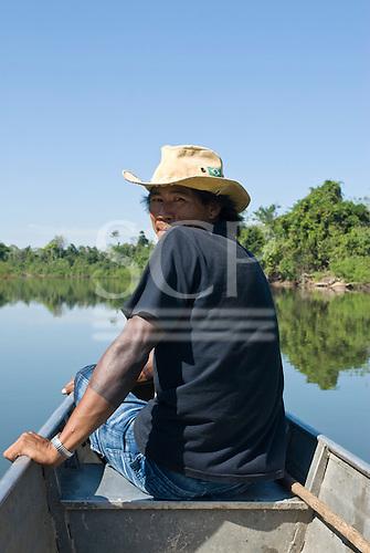 Pará State, Brazil. Rio Fresco river. Boatman Bepran Kayapó watching for rocks between Kikretum and Moikarako.
