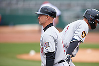 Wisconsin Timber Rattlers manager Matt Erickson (8) congratulates Chad McClanahan (9) for hitting a home run during a Midwest League game against the Lansing Lugnuts at Cooley Law School Stadium on May 1, 2019 in Lansing, Michigan. Wisconsin defeated Lansing 8-3 after the game was suspended from the previous night. (Zachary Lucy/Four Seam Images)