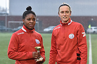 """Esther Buabadi (24) of Zulte-Waregem  pictured receiving the trophee """"Player of the Month December"""" out of hand of Pauline Windels (5) of Zulte-Waregem before a female soccer game between SV Zulte - Waregem and Sporting Charleroi on the eleventh matchday of the 2020 - 2021 season of Belgian Scooore Womens Super League , saturday 23 th of January 2021  in Zulte , Belgium . PHOTO SPORTPIX.BE   SPP   DIRK VUYLSTEKE"""