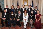 The recipients of the 41st Annual Kennedy Center Honors pose for a group photo following a dinner hosted by United States Deputy Secretary of State John J. Sullivan in their honor at the US Department of State in Washington, D.C. on Saturday, December 1, 2018.  From left to right back row: Deputy Secretary of State Sullivan, Grace Rodriguez, Thomas Kail, Lin-Manuel Miranda, Andy Blankenbuehler, Alex Lacamoire. Front row, left to right:  David M. Rubenstein, Wayne Shorter, Philip Glass, Reba McEntire, Cher, and Deborah F. Rutter.  The 2018 honorees are: singer and actress Cher; composer and pianist Philip Glass; Country music entertainer Reba McEntire; and jazz saxophonist and composer Wayne Shorter. This year, the co-creators of Hamilton, writer and actor Lin-Manuel Miranda; director Thomas Kail; choreographer Andy Blankenbuehler; and music director Alex Lacamoire will receive a unique Kennedy Center Honors as trailblazing creators of a transformative work that defies category.<br /> Credit: Ron Sachs / Pool via CNP