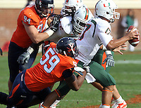 Oct 30, 2010; Charlottesville, VA, USA;   Virginia Cavaliers defensive tackle John-Kevin Dolce (59) puts pressure on Miami Hurricanes quarterback Stephen Morris (17) during the game at Scott Stadium. Virginia won 24-19. Mandatory Credit: Andrew Shurtleff