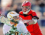 19 March 2011: University of Vermont Catamount Attacker Josh Aronson, a Sophomore from Lutherville, MD, works to maintain possession against Midfielder Matt Hurst, a Junior from Massapequa, NY, during game action against the St. John's University Red Storm at Moulton Winder Field in Burlington, Vermont. The Catamounts defeated the visiting Red Storm 14-9. Mandatory Credit: Ed Wolfstein Photo