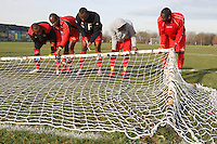 Black Meteors FC players put up the goal nets before a Hackney & Leyton League Sunday Football match at East Marsh, Hackney Marshes - 31/01/10 - MANDATORY CREDIT: Gavin Ellis/TGSPHOTO - Self billing applies where appropriate - Tel: 0845 094 6026