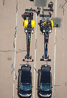 Apr. 28, 2012; Baytown, TX, USA: Aerial view of NHRA top fuel dragster drivers Doug Kalitta (left) and teammate David Grubnic during qualifying for the Spring Nationals at Royal Purple Raceway. Mandatory Credit: Mark J. Rebilas-