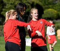 USWMNT players Rachel Buehler and Becky Sauerbrunn explain a drill to Michelle Obama during a Lets Move! soccer clinic held on the South Lawn of the White House.  Let's Move! was started by Mrs. Obama as a way to promote a healthier lifestyle in children across the country.