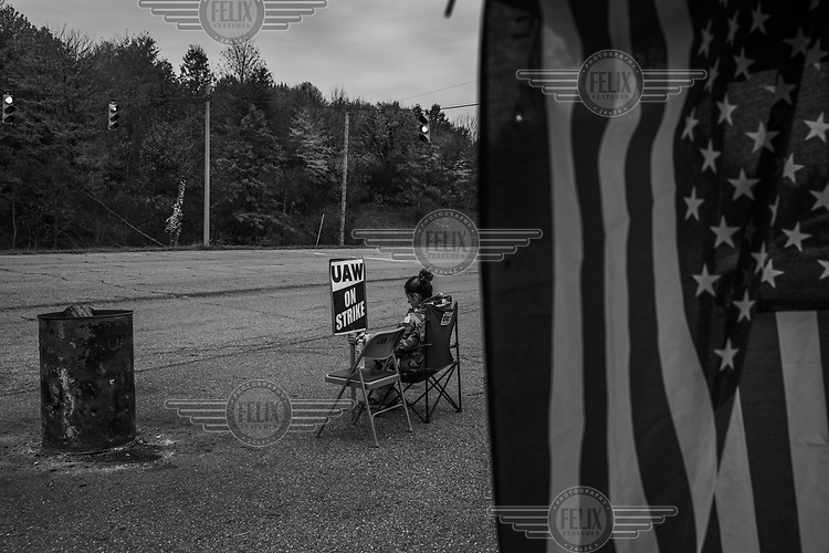 Cynthia Sarabis (54) forms a lone picket in front of the General Motors plant in Lordstown that closed down in 2018.