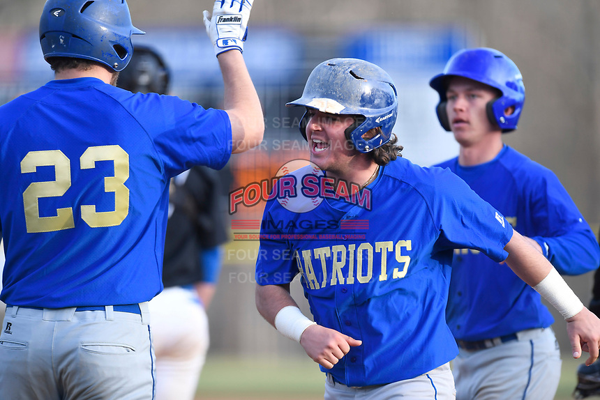 Shortstop Antonio Falbo of the Patrick Henry Patriots is congratulated after hitting a home run in Game 1 of a junior college season-opening doubleheader against the Spartanburg Methodist College Pioneers on February 3, 2018, at Mooneyham Field in Spartanburg, South Carolina. (Tom Priddy/Four Seam Images)