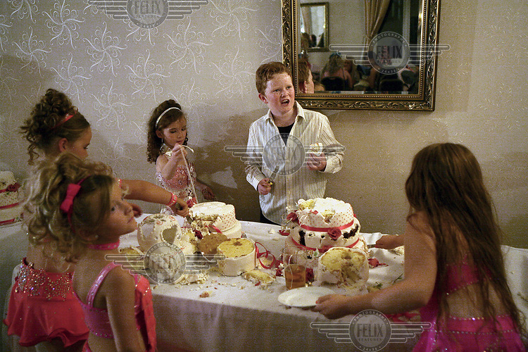 Irish Traveller children demolish a wedding cake at a raucous wedding reception party held at The Thurrock Hotel in Essex.
