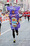 Feb. 27, 2010 - Tokyo, Japan - A runner wearing a popular Japanese snack costume races through the Ginza district part of town during the Tokyo Marathon. Some 36,000 runners participated in this fifth edition of the Tokyo Marathon.