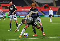 3rd October 2020; Liberty Stadium, Swansea, Glamorgan, Wales; English Football League Championship, Swansea City versus Millwall; Connor Roberts of Swansea City and Ryan Woods of Millwall jostle for possession