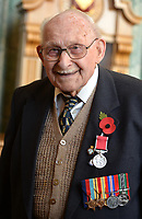 Pictured: Ron Jones Auschwitz survivor who at the age of 100 received the British Empire Medal. STOCK PICTURE<br /> Re: The oldest poppy seller has died at the age of 102.<br /> Ron Jones, of Bassaleg near Newport, south Wales, was detained at Auschwitz concentration camp from October 1943 until January 1945 after being captured in Benghazi, Libya.<br /> He worked at the IG Farben chemical factory from 6am until 6pm, six days a week and now travels by car to share his haunting memories with school children up and down the county.