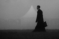 A Czech cleric with a suitcase arrives during the foggy morning for the open-air mass served by the Pope Benedict XVI in Stara Boleslav, one of the main pilgrimage site of the Czech Republic, September 28, 2009.