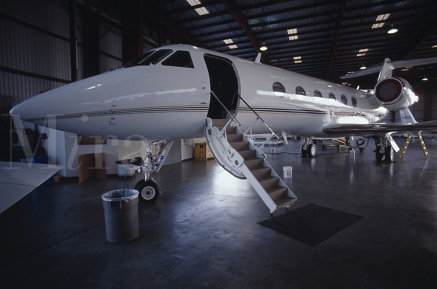Jet in airport hanger.