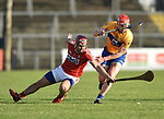 Richard Cahalane of Cork  in action against Niall Deasy of Clare during their Munster Hurling League game at Cusack Park. Photograph by John Kelly.
