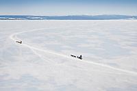 Martin Buser and Zack Steer<br /> run on frozen Norton Bay on their way to Koyuk during the 2010 Iditarod