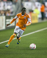 Houston Dynamo defender Kofi Sarkodie (8)  The New England Revolution played to a 1-1 draw against the Houston Dynamo during a Major League Soccer (MLS) match at Gillette Stadium in Foxborough, MA on September 28, 2013.