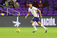 ORLANDO CITY, FL - JANUARY 31: Miles Robinson #12 of the United States moves with the ball during a game between Trinidad and Tobago and USMNT at Exploria stadium on January 31, 2021 in Orlando City, Florida.