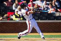 Woody Wallace (10) of the Cincinnati Bearcats follows through on his swing against the Radford Highlanders at Wake Forest Baseball Park on February 22, 2014 in Winston-Salem, North Carolina.  The Highlanders defeated the Bearcats 6-5.  (Brian Westerholt/Four Seam Images)