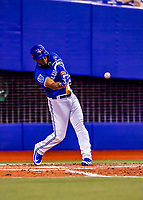 26 March 2018: Toronto Blue Jays outfielder Teoscar Hernandez hits an RBI triple in the 7th inning of an exhibition game against the St. Louis Cardinals at Olympic Stadium in Montreal, Quebec, Canada. The Cardinals defeated the Blue Jays 5-3 in the first of two MLB pre-season games in the former home of the Montreal Expos. Mandatory Credit: Ed Wolfstein Photo *** RAW (NEF) Image File Available ***