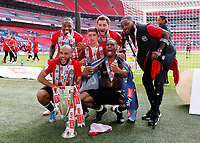 29th May 2021; Wembley Stadium, London, England; English Football League Championship Football, Playoff Final, Brentford FC versus Swansea City; Bryan Mbeumo, Ivan Toney, Josh Dasilva, Tariqe Fosu, Vitaly Janelt and and Charlie Goode of Brentford all celebrate with the Sky Bet EFL Championship Plays-off Trophy and their 2-0 win and promotion to the Premier League