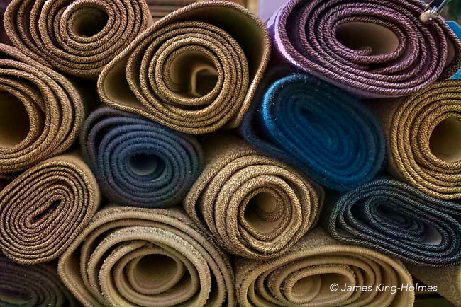 The ends of rolls of carpet on a market stall in Stamford, Lincolnshire, UK