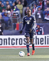 Sporting Kansas City defender Ike Opara (3) brings the ball forward.   In a Major League Soccer (MLS) match, Sporting Kansas City (blue) tied the New England Revolution (white), 0-0, at Gillette Stadium on March 23, 2013.