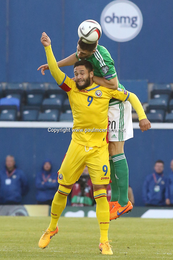 Romania's  Florin Andone comes into contact with  Northern Ireland's Craig Cathcart during the UEFA EURO 2016 qualifying Group F soccer match between Northern Ireland and Romania at Windsor Park in Belfast, Northern Ireland, 13 June 2015.  EPA/PauL McErlane