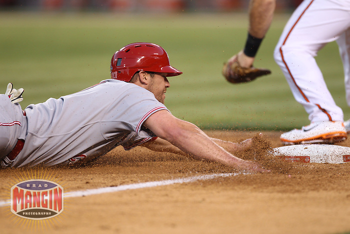ANAHEIM - JULY 13:  Scott Rolen of the National League slides into third base in the All Star Game at Angel Stadium on June 13, 2010 in Anaheim, California. Photo by Brad Mangin