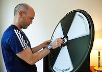 08 SEP 2011 - BEIJING, CHN - Iain Dawson checks a wheel as he  prepares his tandem with guide Liam Gentry at their hotel before the ITU World Paratriathlon Championships .(PHOTO (C) NIGEL FARROW)
