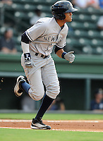Outfielder Mason Williams (9) of the Charleston RiverDogs, a New York Yankees affiliate, in a game against the Greenville Drive on June 21, 2012, at Fluor Field at the West End in Greenville, South Carolina. Charleston won, 2-1. Williams is the Yankees' No. 5 prospect, according to Baseball America. (Tom Priddy/Four Seam Images)