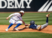 IMG Academy Ascenders shortstop Drake Varnado (9) attempts to tag Sean Ambrose (1) sliding into second base during a game against the Calvary Christian Academy Eagles on March 13, 2021 at IMG Academy in Bradenton, Florida.  (Mike Janes/Four Seam Images)