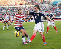 Tobin Heath (17) of the USWNT has the ball cleared away from her by Jane Ross (13) of Scotland during the game at EverBank Field in Jacksonville, Florida.  The USWNT defeated Scotland, 4-1.