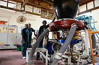 RWANDA, Kigali, plastic recycling at company Ecoplastics, extruder machine KABRA which is generating the plastic liquid from which the plastic foils are manufactured