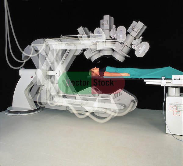 multiple exposure of patient lying on operating table in catheritization lab while x-ray device shifts position for different angles of view