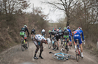Gediminas Bagdonas (LTU/AG2R-LaMondiale) crashes & is left in pain at 31km. He would soon resume the race though.<br /> <br /> 11th Strade Bianche 2017