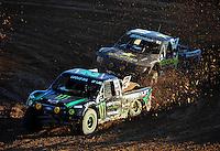 Dec. 10, 2011; Chandler, AZ, USA;  LOORRS pro 2 unlimited driver Jeremy McGrath (2) and Rob MacCachren (1) during round 15 at Firebird International Raceway. Mandatory Credit: Mark J. Rebilas-