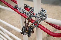 Combination lock and chain on a farm gate