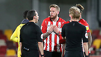 Brentford captain, Pontus Jansson speaks to referee, Dean Whitestone at the final whistle during Brentford vs Birmingham City, Sky Bet EFL Championship Football at the Brentford Community Stadium on 6th April 2021