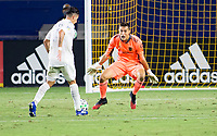 CARSON, CA - SEPTEMBER 06: Cristian Pavon #10  of the Los Angeles Galaxy moves with the ball towards Pablo Sisniega #23 GK LAFC during a game between Los Angeles FC and Los Angeles Galaxy at Dignity Health Sports Park on September 06, 2020 in Carson, California.
