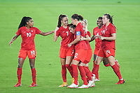 YOKOHAMA, JAPAN - AUGUST 6: Jessie Fleming #17 of Canada celebrates scoring with teammates during a game between Canada and Sweden at International Stadium Yokohama on August 6, 2021 in Yokohama, Japan.