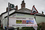 "© Joel Goodman - 07973 332324 . 26/01/2014 . Salford , UK . A banner reading "" Salford says no fracking anywhere "" suspended between signposts at the entrance to the approach road to the fracking site , on Barton Moss Road . Approximately 500 protesters march to an iGas fracking exploration site at Barton Moss , Salford , today (Sunday 26th January 2014) . They walk along the A57 road , blocking traffic as they do . A long term protest camp has been established on an access road leading to the site and today (26th January) protesters from other areas of the country travelled to the site to join with other protesters against fracking . Photo credit : Joel Goodman"
