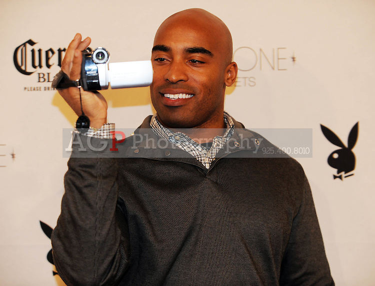 """Tiki Barber videotapes the media at Playboy's ninth annual """"Super Saturday Night""""  party in at Playboy's Desert Oasis and Resort in Chandler, Arizona Saturday February 2, 2008.   (Photo by Alan Greth)"""
